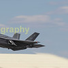 The USAF's Lightning II makes a fast low pass along the crowd line