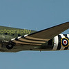 The Dakota flies low and slow along the crowd line