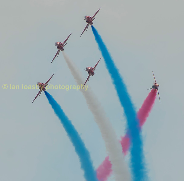 Painting in red, white & blue smoke  in the air over Gloucestershire