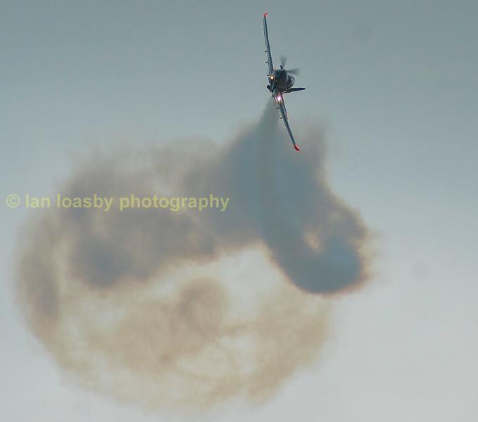 One of the Polish team's PZL-130L making smoke trails