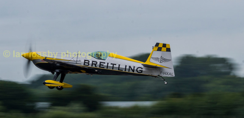 I only got one shot of this display by European aerobatic champion Aude Lemordant in her Breitling liveried Extra 330SC as she took off to start her display