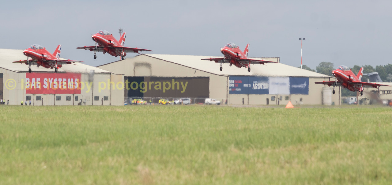 'Hi ho, hi ho, it's off to work we go.'  The Red Arrows take off to prepare for the show stopping flypast with a Typhoon and new F35b jumpjet