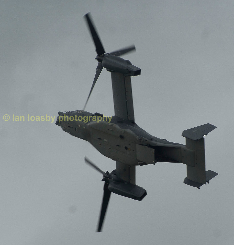 Is this a helicopter or an airplane ? it is in fact the unique  Bell /Boeing v-22 Osprey. It is the only tilt rotor aircraft in production. The engines can rotate allowing the aircraft to become a helicopter.