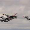 Right to left , (nearest to furthest away), Thunderbird 2 Flown by Cpt. Ryan Bodenheimer,  Thunderbird 1 flown by team leader Lt.Col Jason Heard (shifty),  Thunderbird 3 flown by Maj Nate Hofmann, and furthest away thunderbird 4 flown by Maj Nick Krajicek