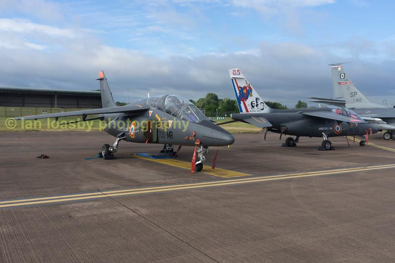 A pair of French airforce Alpha Jet Trainers designatd Dassaut / Dornier Alpha Jet E ( E= Ecole -School) on the static dispay line.