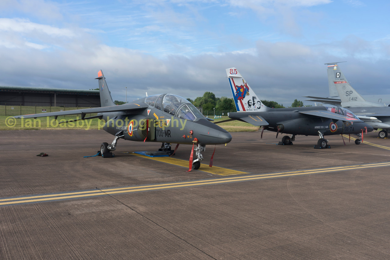 A pair of French airforce Alpha Jet Trainers designatd Dassaut / Dornier Alpha Jet E ( E= Ecole -School) on the static dispay line.