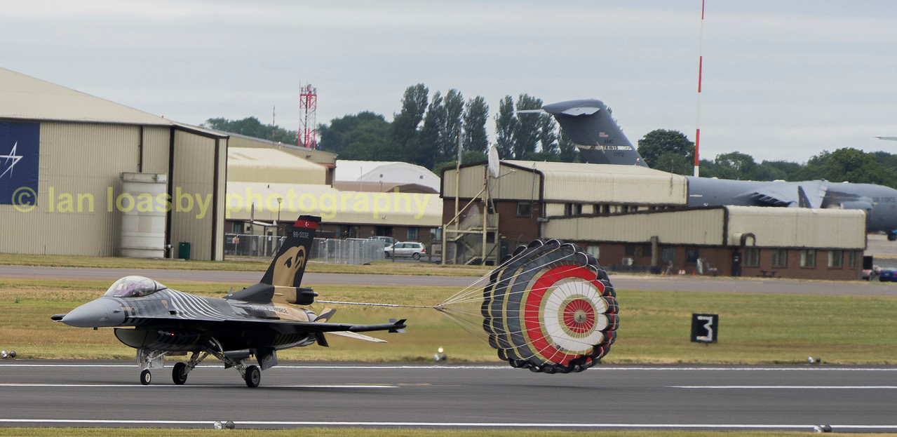 Showing the parachute breaking on  the F-16C  at the end of his display is solo turk 88-0029