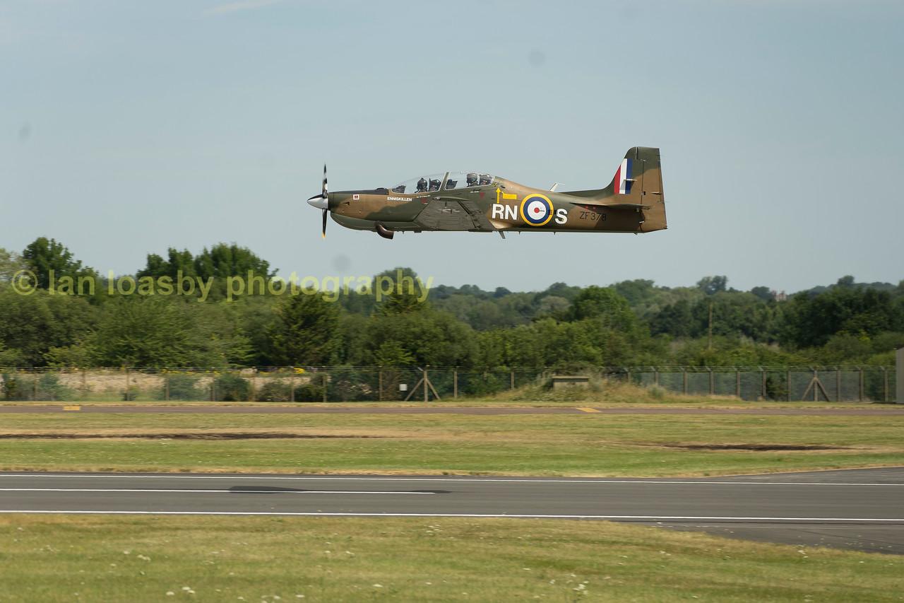 'Spitfire'  liveried Tucano ZF378 / RN-5 departs RIAT for 1FTS / 72(V) Sqn
