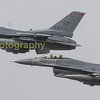 Two F-16's fly past