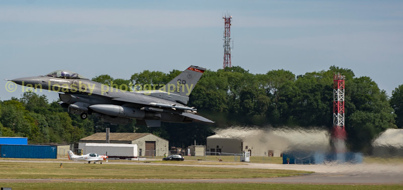 F-16 91-0412 of the 52nd FW / 480 FS departs