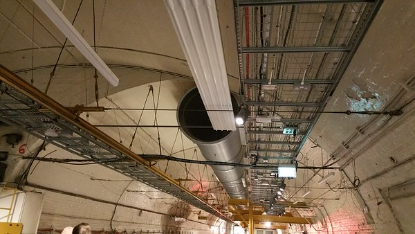 Ducting plus bus bars adorn the ceiling.