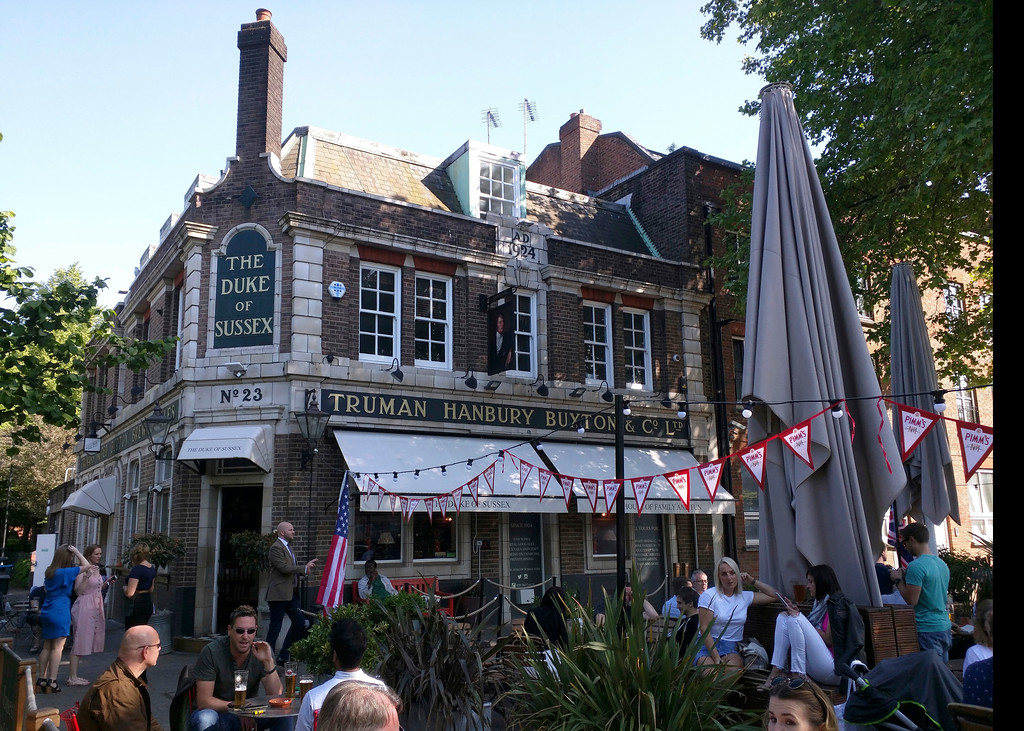 . Patrons drink on the terrace of the Duke of Sussex pub near London\'s Waterloo Station. Although tens of thousands of royal fans lined  the parade route in Windsor, many here expressed benign indifference to the royal wedding Saturday. (AP Photo/Raphael Satter)