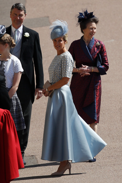 . Britain\'s Sophie, Countess of Wessex, center, Britain\'s Princess Anne, right, and Timothy Laurence arrive for the wedding ceremony of Prince Harry and Meghan Markle at St. George\'s Chapel in Windsor Castle in Windsor, near London, England, Saturday, May 19, 2018. (Odd Anderson/pool photo via AP)