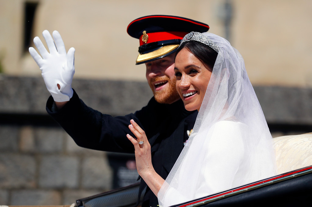 . Britain\'s Prince Harry and his wife Meghan Markle ride a horse-drawn carriage, after their wedding ceremony at St. George\'s Chapel in Windsor Castle in Windsor, near London, England, Saturday, May 19, 2018. (Phil Noble/pool photo via AP)