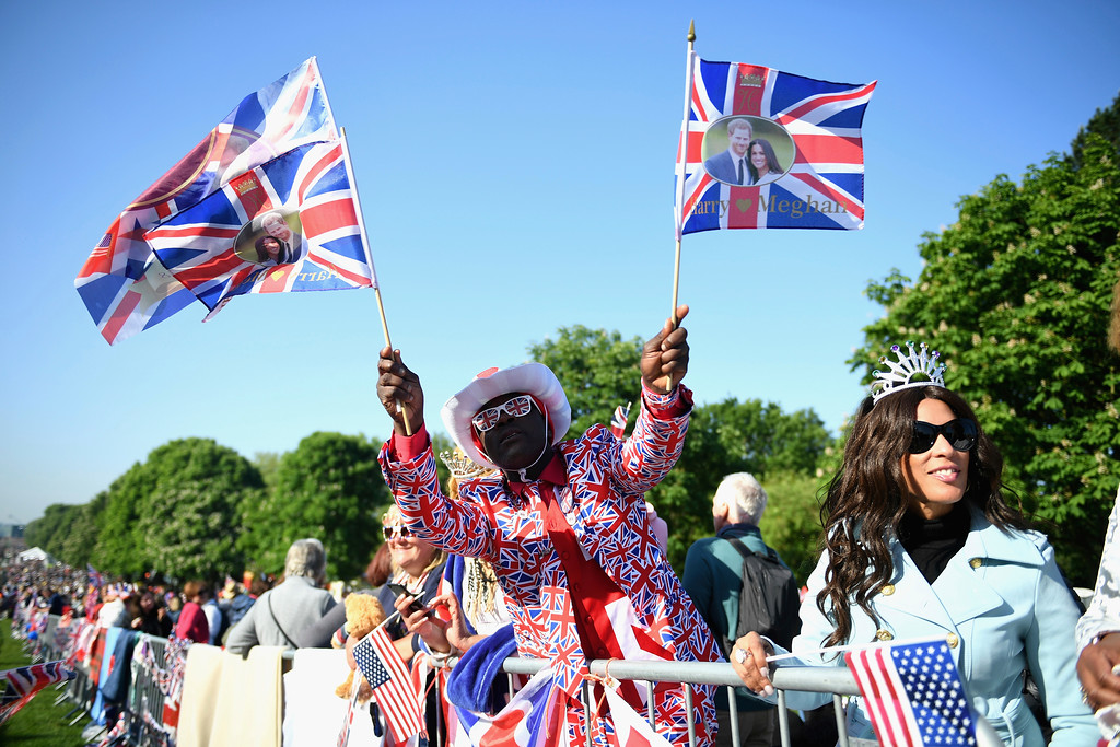 . A royal fan celebrates on the Long Walk after Meghan Markle and Britain\'s Prince Harry\'s wedding ceremony at St. George\'s Chapel in Windsor Castle in Windsor, near London, England, Saturday, May 19, 2018. (Jeff J Mitchell/pool photo via AP)