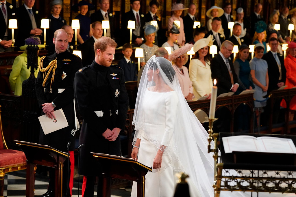 . Britain\'s Prince Harry and Meghan Markle smile during their wedding ceremony in St. George\'s Chapel in Windsor Castle in Windsor, near London, England, Saturday, May 19, 2018. (Jonathan Brady/pool photo via AP)