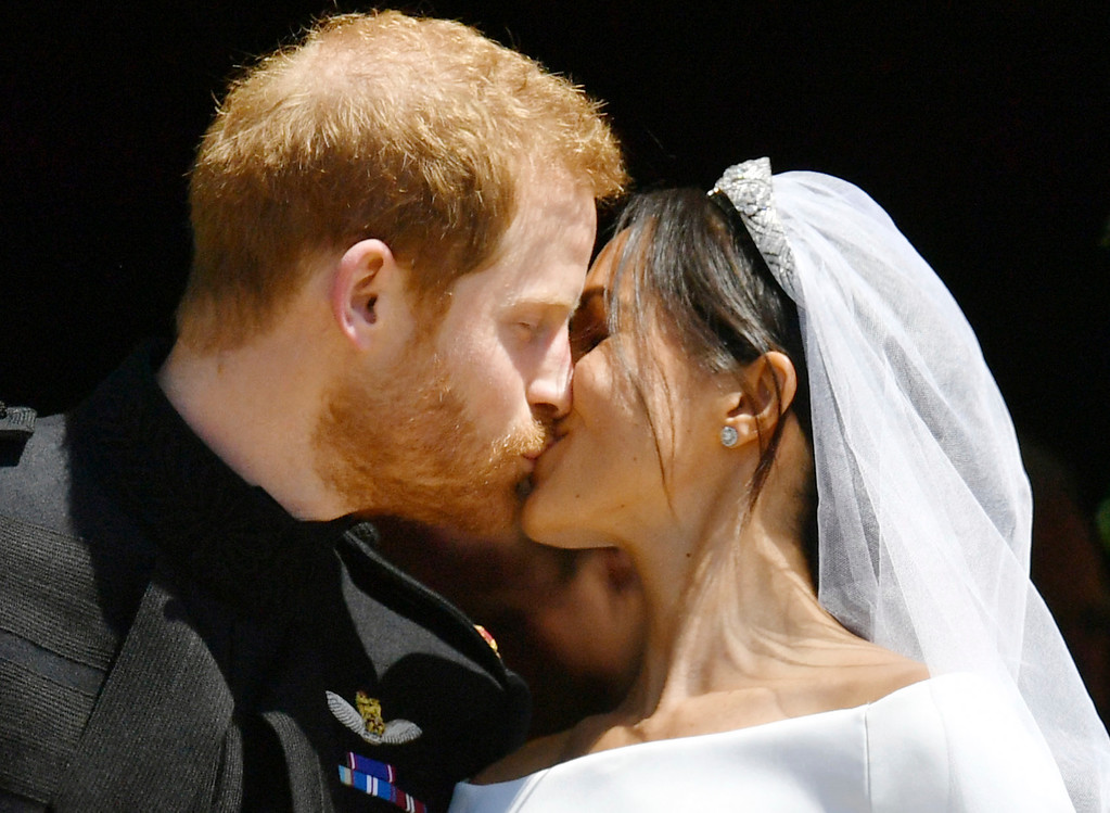 . Prince Harry and Meghan Markle kiss on the steps of St George\'s Chapel in Windsor Castle after their wedding in Windsor, near London, England, Saturday, May 19, 2018. (Ben Birchhall/pool photo via AP)