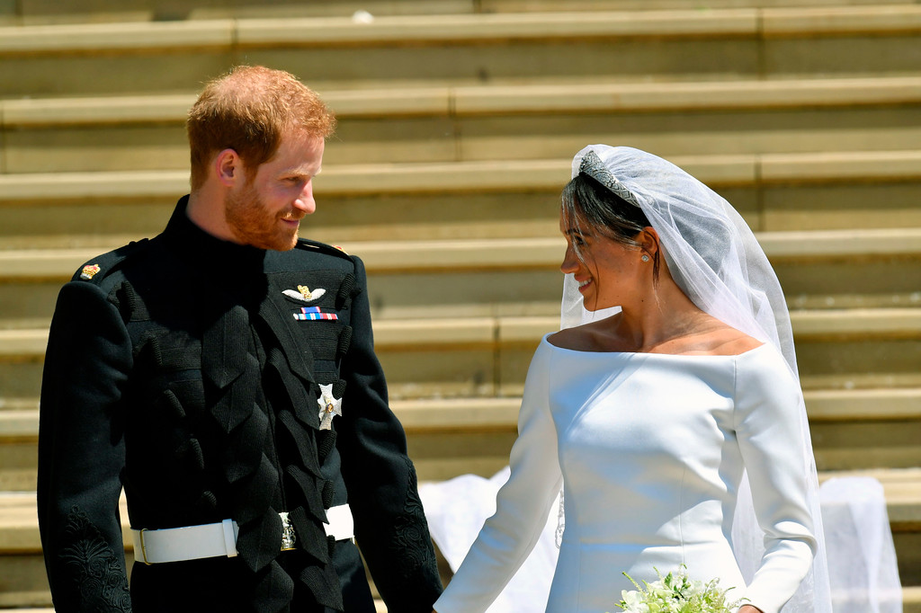 . Prince Harry and Meghan Markle walk down the steps after their wedding at St. George\'s Chapel in Windsor Castle in Windsor, near London, England, Saturday, May 19, 2018. (Ben Birchhall/pool photo via AP)