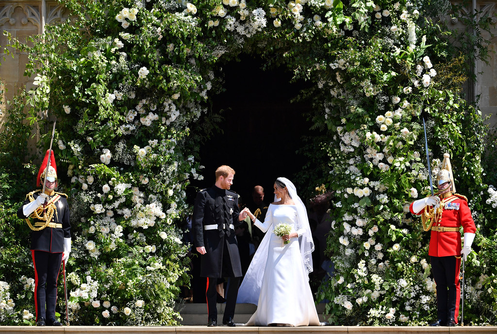 . Prince Harry and Meghan Markle leave after their wedding ceremony at St. George\'s Chapel in Windsor Castle in Windsor, near London, England, Saturday, May 19, 2018. (Ben Birchhall/pool photo via AP)