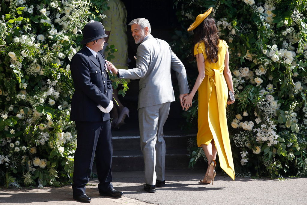 . George Clooney and his wife Amal Clooney arrive for the wedding ceremony of Prince Harry and Meghan Markle at St. George\'s Chapel in Windsor Castle in Windsor, near London, England, Saturday, May 19, 2018. (Odd Anderson/pool photo via AP)