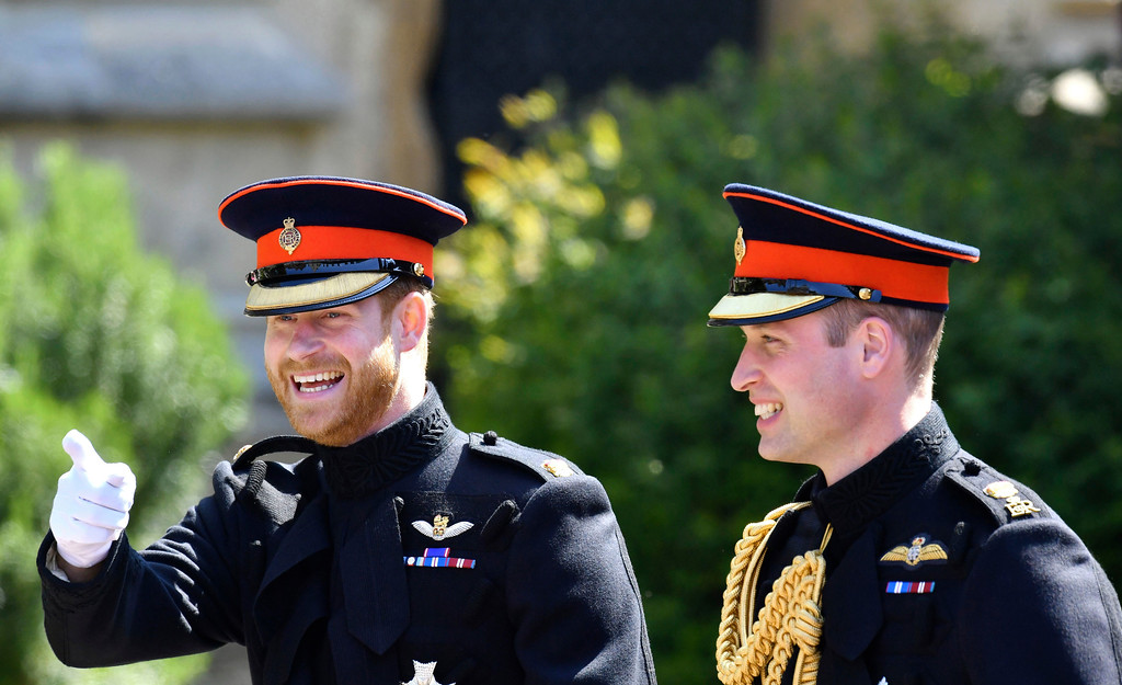 . Britain\'s Prince Harry, left, reacts as he walks with his best man, Prince William the Duke of Cambridge, as they arrive for the the wedding ceremony of Prince Harry and Meghan Markle at St. George\'s Chapel in Windsor Castle in Windsor, near London, England, Saturday, May 19, 2018. (Ben Birchhall/pool photo via AP)