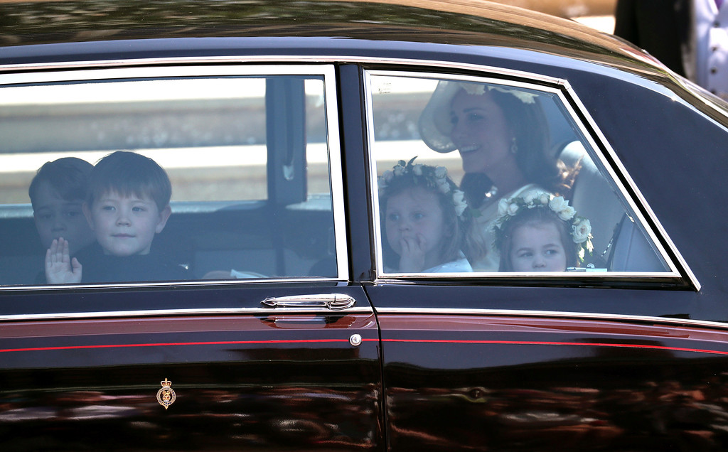 . Kate, the Duchess of Cambridge arrives with Prince George, left and Princess Charlotte, right, for the wedding  ceremony of Prince Harry and Meghan Markle at St. George\'s Chapel in Windsor Castle in Windsor, near London, England, Saturday, May 19, 2018. (Jane Barlow/pool photo via AP)