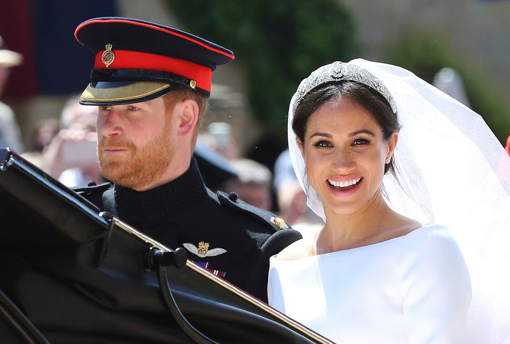 . Britain\'s Prince Harry and his wife Meghan Markle leave after their wedding ceremony, at St. George\'s Chapel in Windsor Castle in Windsor, near London, England, Saturday, May 19, 2018. (Gareth Fuller/pool photo via AP)