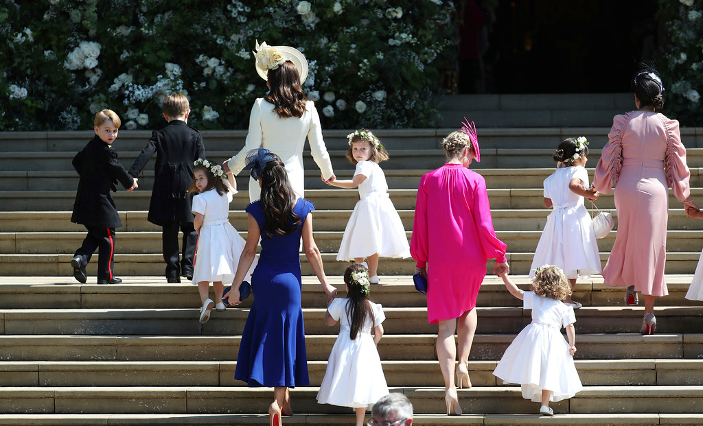 . Britain\'s Prince George, left, Princess Charlotte, third left, Kate, the Duchess of Cambridge, background fourth left and Jessica Mulroney foreground arrive with the bridesmaids and page boys for the wedding ceremony of Prince Harry and Meghan Markle at St. George\'s Chapel in Windsor Castle in Windsor, near London, England, Saturday, May 19, 2018. (Jane Barlow/pool photo via AP)