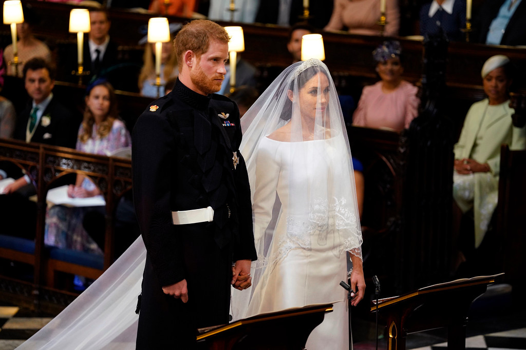 . Britain\'s Prince Harry and Meghan Markle stand, prior to the start of their wedding ceremony, at St. George\'s Chapel in Windsor Castle in Windsor, near London, England, Saturday, May 19, 2018. (Dominic Lipinski/pool photo via AP)