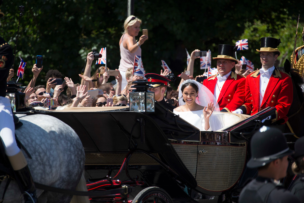 . Britain\'s Prince Harry and his wife Meghan Markle leave after their wedding ceremony, at St. George\'s Chapel in Windsor Castle in Windsor, near London, England, Saturday, May 19, 2018. (Photo by Joel C Ryan/Invision/AP)