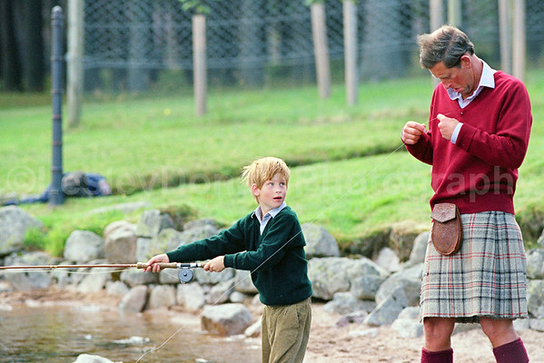 Prince Charles teaches Prince Harry to Fly-fish on The Balmoral Estate. Exclusive picture  © Lesley Donald