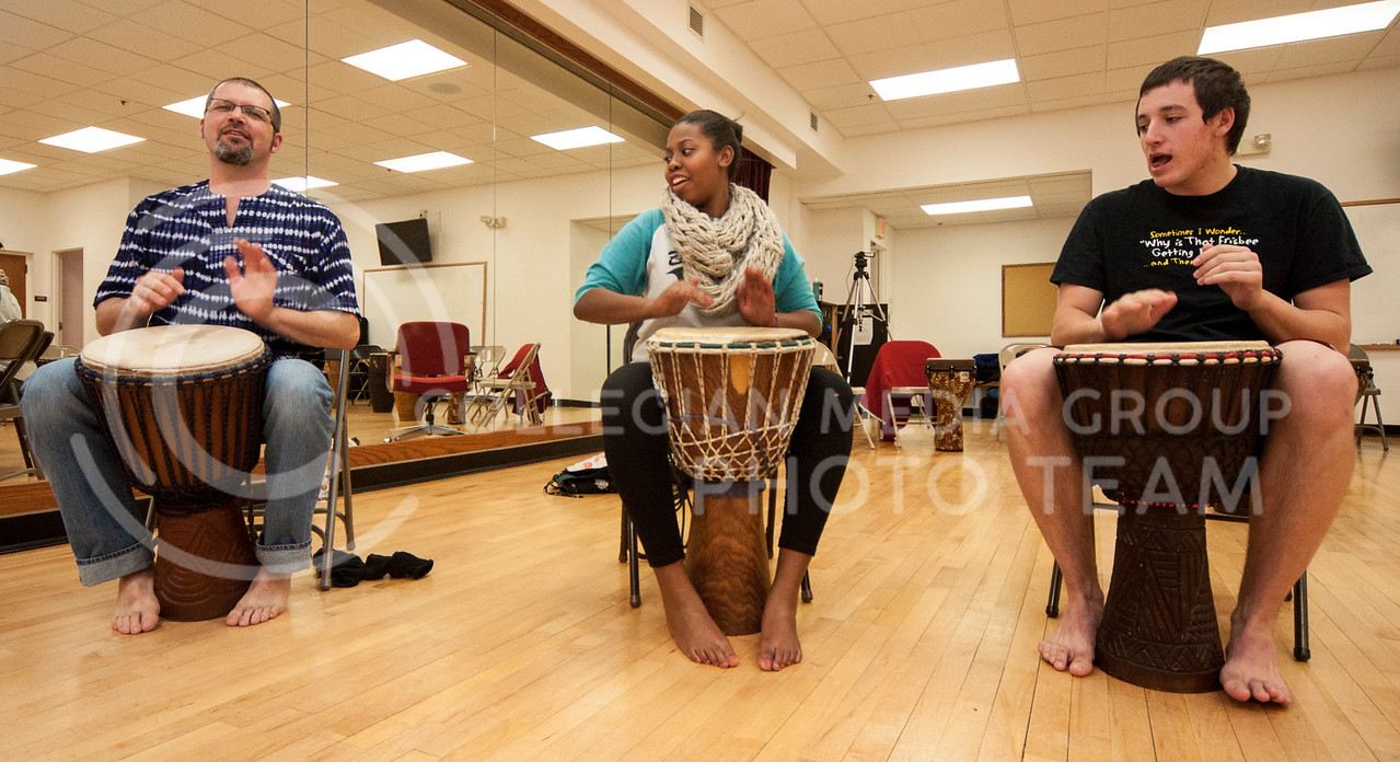 Instructor Neil Dunn, Erika Williams, senior in theater, and another student drum while the other students dance in the African Dance class in NIchols Hall on March 3.