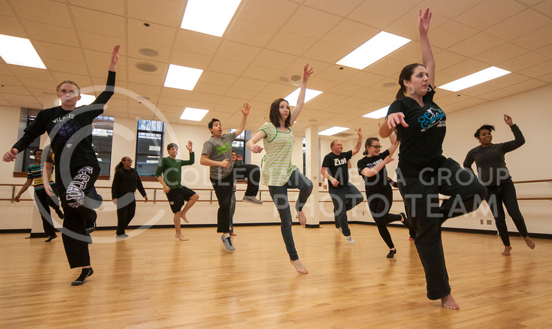 Students in the African Dance class jump while rehearsing a dance in Nichols Hall on March 3.