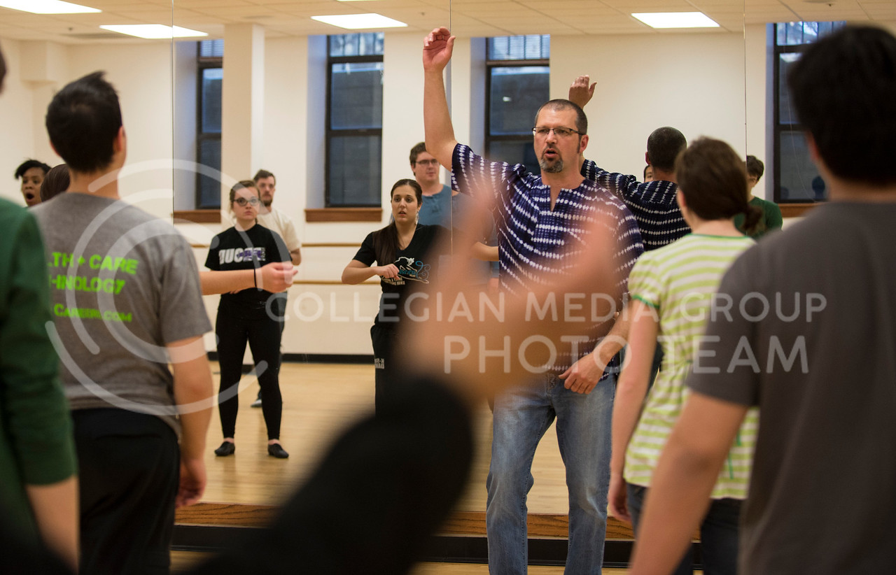 Instructor Neil Dunn demonstrates a dance move in his African Dance class in Nichols Hall on March 3.