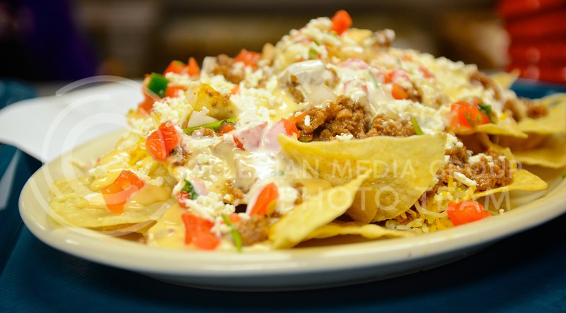 A heaping plate of beef nachos is just one of the many mexican-themed dishes Fuzzy's Taco Shop has to offer. The restaurant with the funny name recently opened in Aggieville in the property vacated by the Hibachi Hut. Parker Robb | Royal Purple