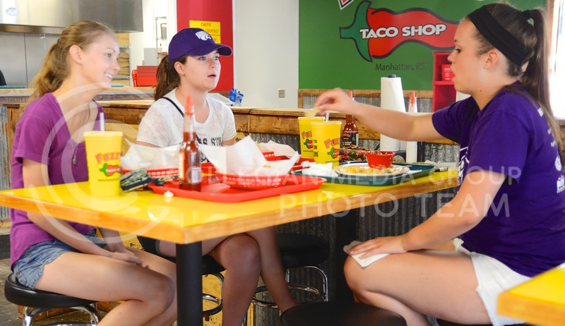 From left to right, Allie Owens, junior in animal science, Abby Thomann, junior in public relations, and Ashley Clark, junior in marketing, enjoy their meal Tuesday evening at Fuzzy's Taco Shop. The restaurant with the funny name recently opened in Aggieville in the property vacated by the Hibachi Hut. Parker Robb | Royal Purple