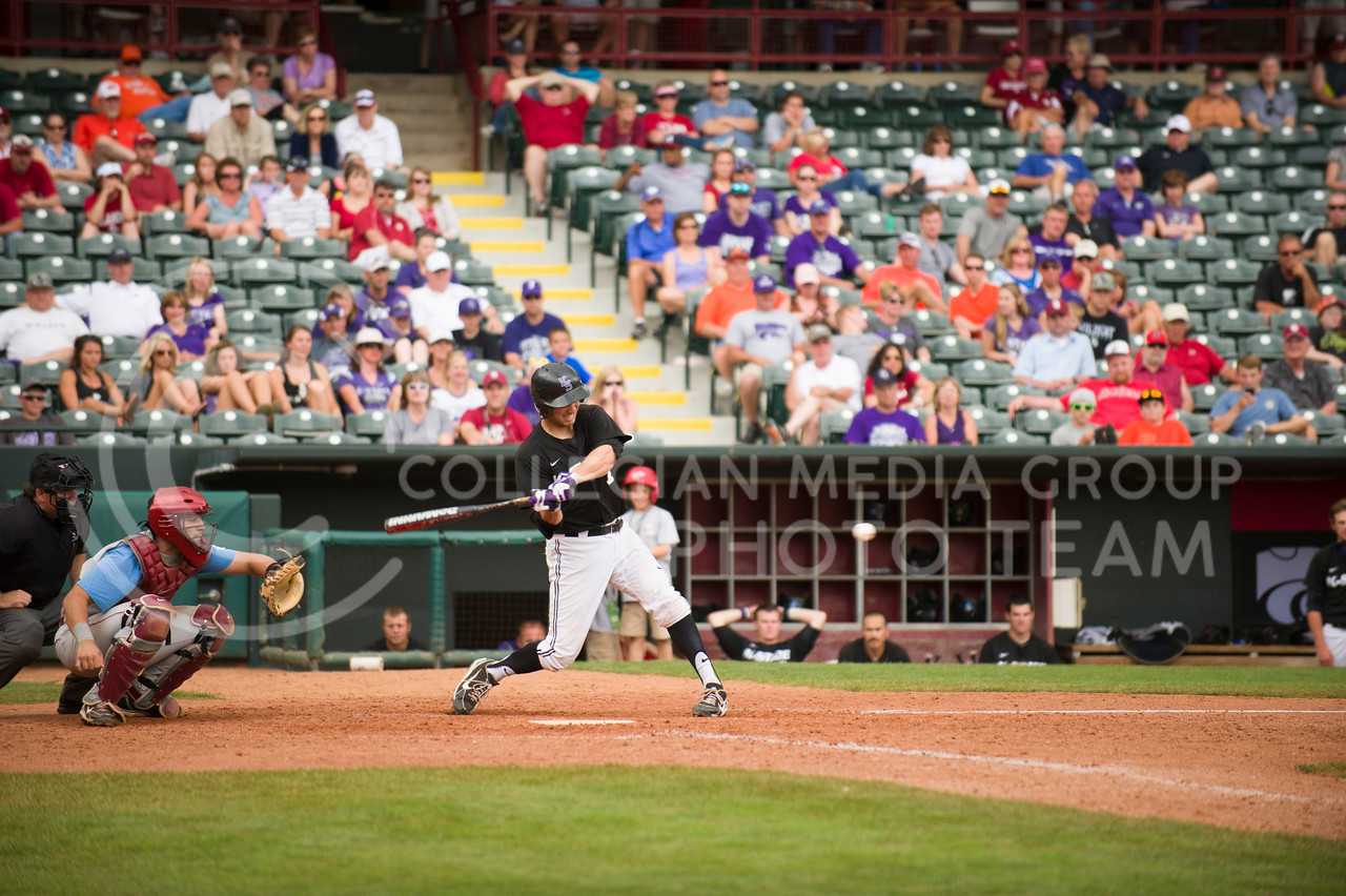 Junior infielder Ross Kivett swings for a hit at the Big 12 Championship Tournament on May, 25, 2013 in the loss to Oklahoma.