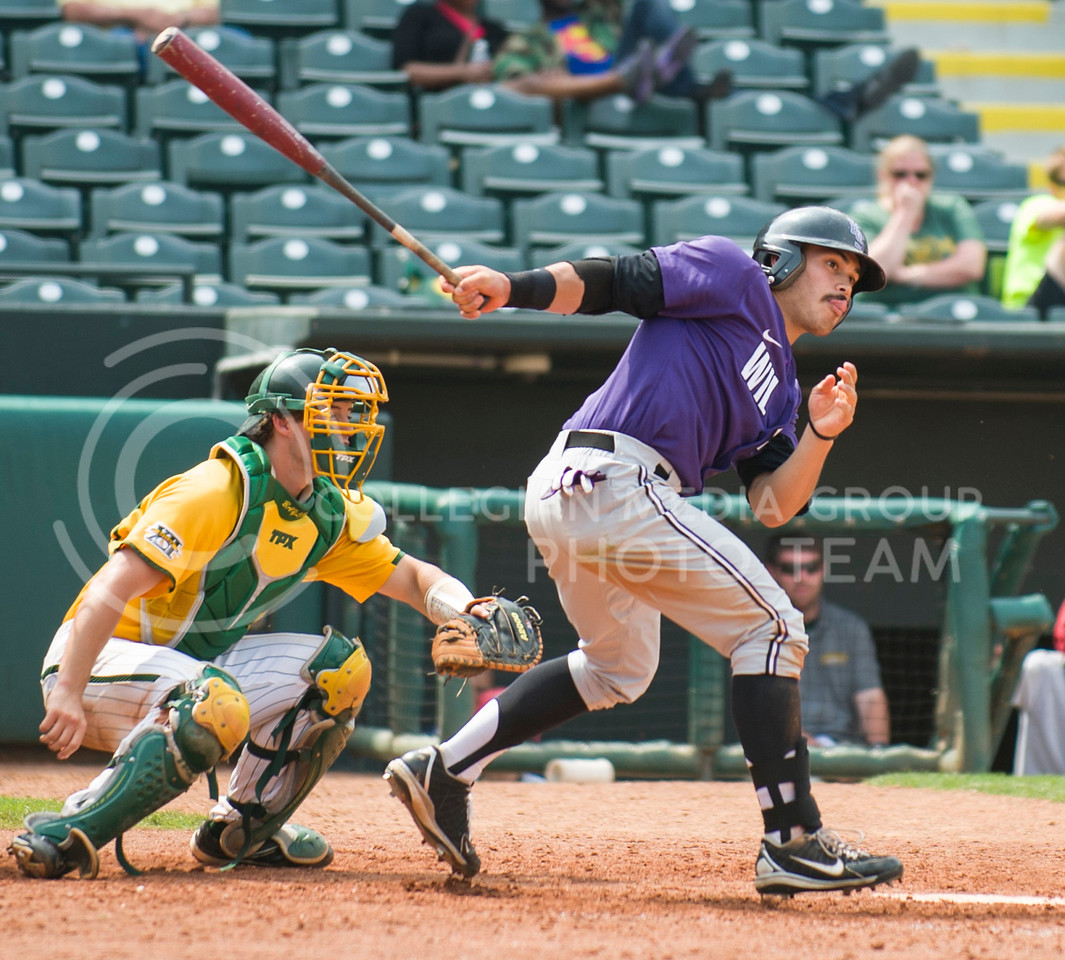 2013 Senior Jon Davis watches his hit fly on May 24, 2013 at the Big 12 Championship Tournament in Oklahoma.