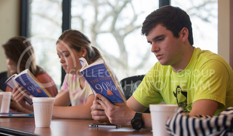 "Andrew Kinskey, sophmore in psychology, and Anna Pyle, freshman in family studies and human services, read ""The Other 90%"" by Robert K. Cooper, which is about self development, in class in Leadership Studies on March 10."