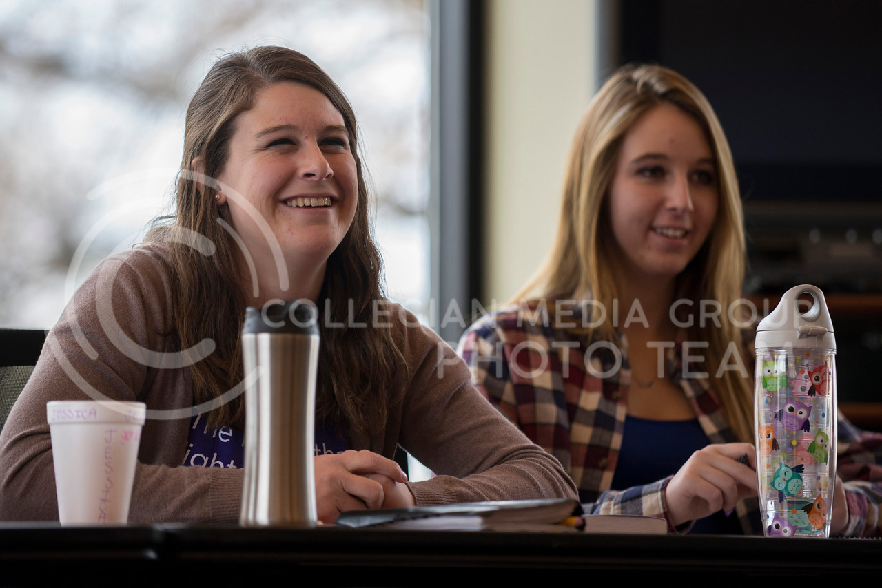 Jessica Van Ranker (left), freshman in political science, and Mikaela Kluver, freshman in psychology and biology, laugh at funny and motivational video during their small group session on March 10 in the Leadership Studies.