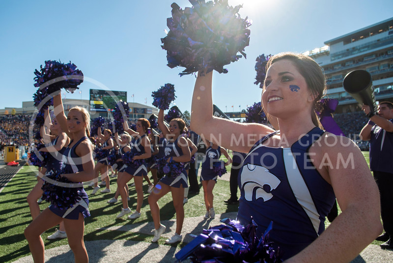 Kelsey Unrein, sophomore in Hospitality Management, cheers to the student section at the KSU vs. West Virginia, on Oct. 26, 2013 in Bill Snyder Fmaily Stadium.