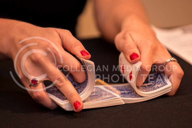 A Chi-O dealer shuffles a deck of cards for a game of poker at the Chi-O Casino at Holiday Inn on Feb. 25.