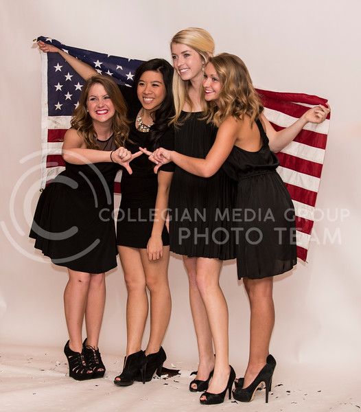 from left: Katherine Bourk, junior in public relations, Theresa Hoang, junior in biology, Mallory Keating, junior in finance, and Brooke Dechant, junior in hotel and resturant management, pose at the photo booth at the Chi-O Casino at Holiday Inn on Feb. 25.