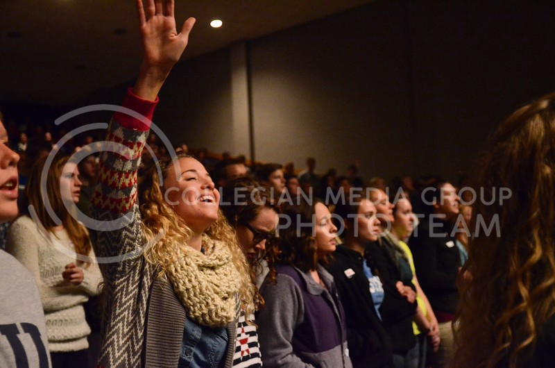 Katie Cook, junior in elementary education, worships during the central gathering Thursday, October 24, in Forum Hall in the K-State Student Union.