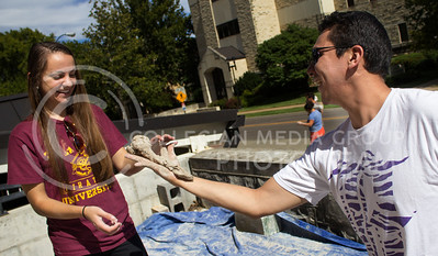 Isaac Falcon, a secon-year graduate student in family studies, makes a rose out of clay and gives it to his girl friend, Maria Blythe, a graduate student studying Accounting at University of Missouri - Kansas City.  The second annual Clay Stomp was held Saturday, Sept. 28, 2013 from 10am to 3pm outside of Willard Hall. All K-students were welcome to come with their barefeet to mix 4,000 pounds of clay, which would later be bagged and used by art students.