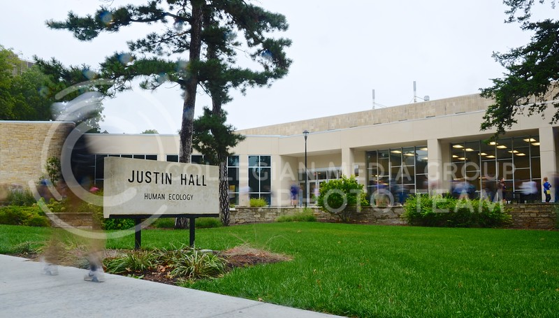 Students walk in and out of Justin Hall, home of the College of Human Ecology, on their way to and from classes Monday morning. The new addition to the building recently received a LEED certification from the US Green Building Council.