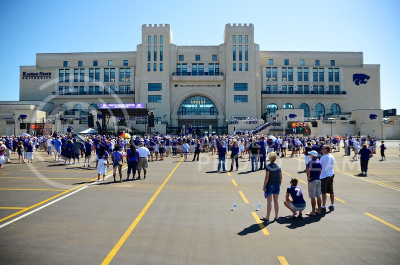 """K-State fans and Manhattan residents alike flocked to Bill Snyder Family Stadium Friday morning for the dedication of the recently-completed $90-million West Stadium Center and the unveiling of a statue honoring Bill Snyder, the """"architect of the greatest turnaround in college football history."""""""