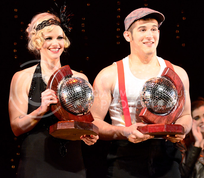 Michelle Williams, sophomore in kinesiology, and Chance Berndt, K-State student ambassador, receive the mirror ball trophies for winning season 6 of Dancing with the K-State Stars: Evolution of Dance with their serious, risqué tango from the 2000s. Williams and Berndt received perfect preliminary scores of 10 from all three judges.