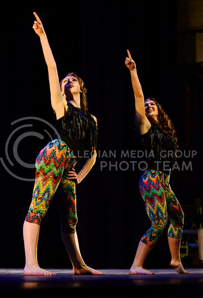 Carolyn Fitzgibbons, senior in theater (left), and Kaitlyn Dewell, Miss K-State 2013, dance a modern dance to 1970s music during season 6 of Dancing with the K-State Stars Tuesday evening in McCain Auditorium.