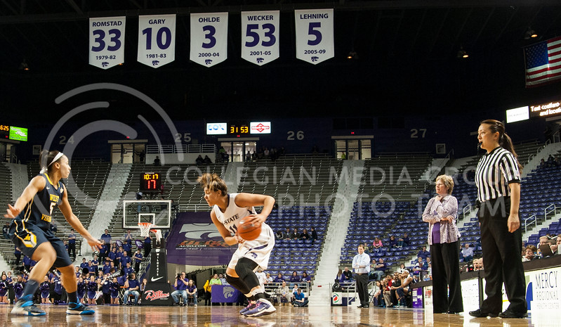 Head coach Deb Patterson watches as senior guard Chantay Caron looks to pass around the West Virginia defense on February 22 at Bramlage Coliseum